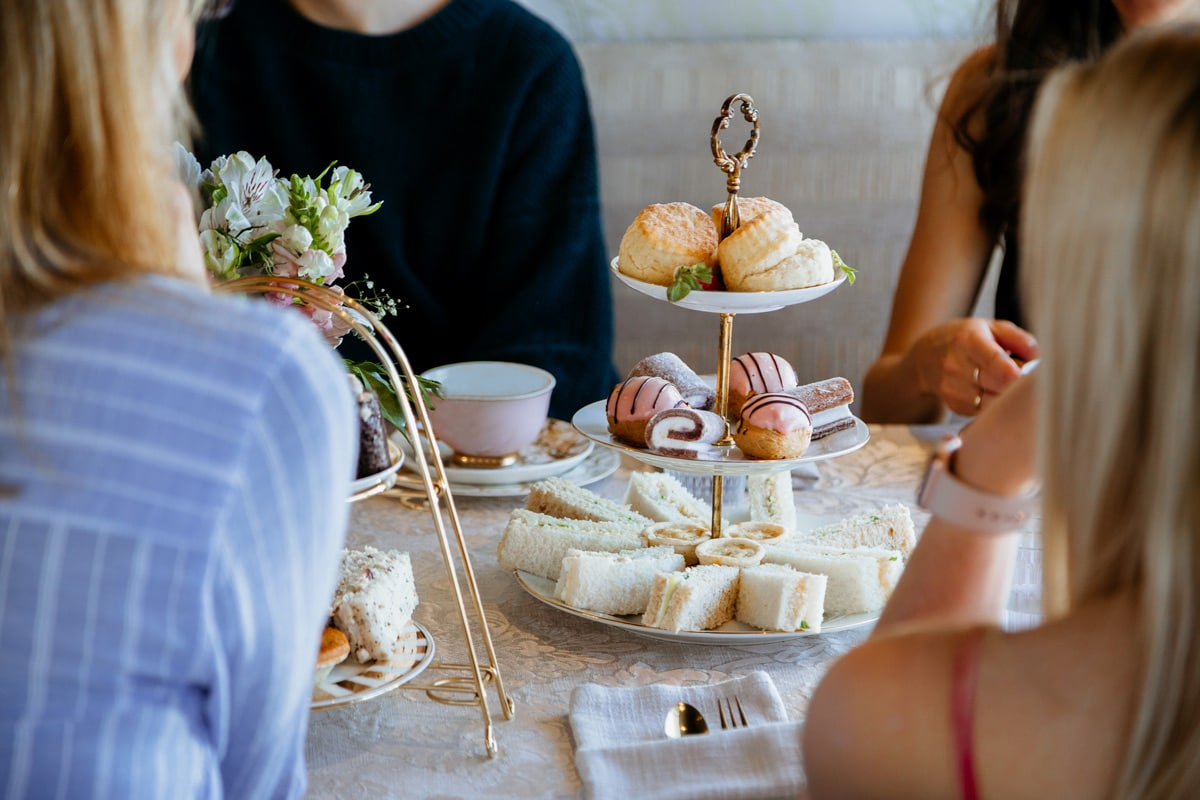high tea food with ladies