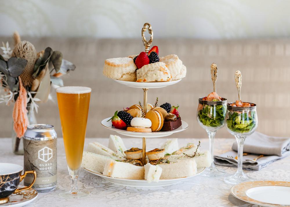 high tea table setting with food